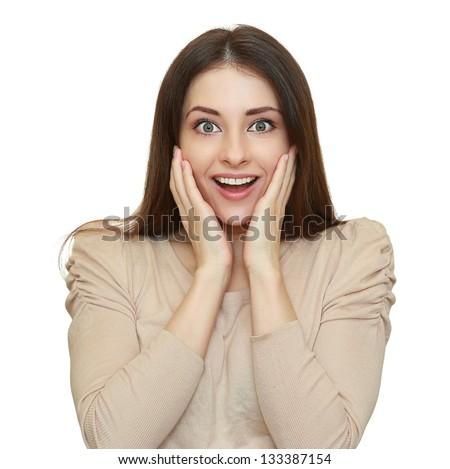 Surprised woman with opened mouth and big eyes holding hands the face and looking happy isolated on white background - stock photo
