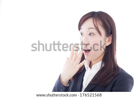 surprised young business woman isolated on white background  - stock photo