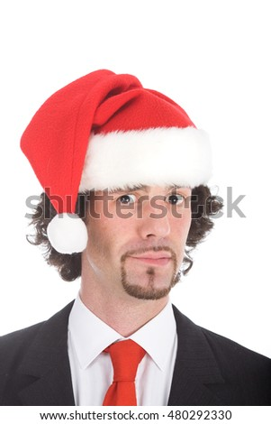surprised young businessman expression with santa hat isolated on white
