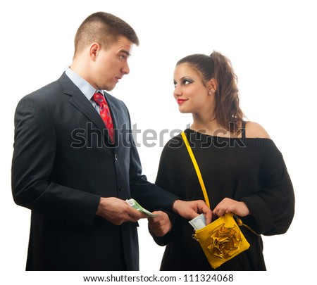 Surprised young businessman giving too much money to the lady of questionable moral. - stock photo