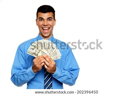 Surprised young businessman in blue shirt shows your money, right you can write some text - stock photo