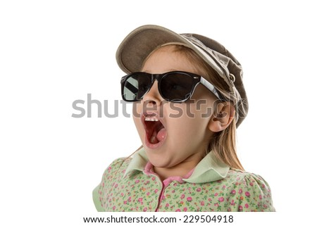 Surprised - Young girl in green hat and sunglasses, expressing shock and surprise.  Looking at copy space or other object / scene.  Isolated on white. - stock photo
