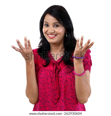 Surprised young Indian woman - stock photo