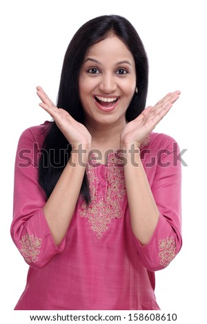 Surprised young indian woman against white background - stock photo