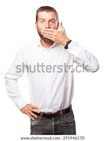 surprised young man covering mouth gesture - stock photo