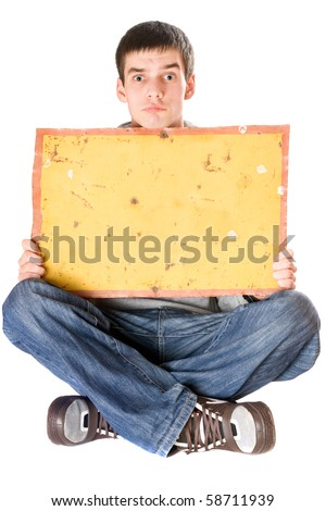 Surprised young man holding vintage yellow board - stock photo