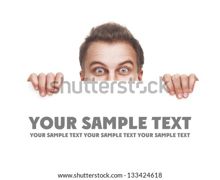 surprised young man holding white empty paper isolated on white background - stock photo