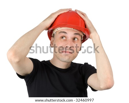 Surprised young man in a red building helmet