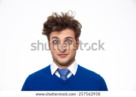 Surprised young man looking at the camera over white background - stock photo