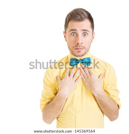 Surprised young man wearing yellow shirt and green bowtie - stock photo