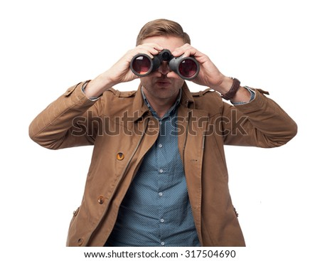 surprised young man with binoculars - stock photo