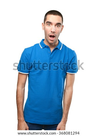 Surprised young man with mouth open - stock photo
