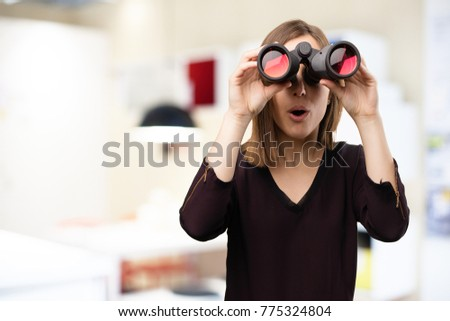 surprised young pretty woman with binoculars