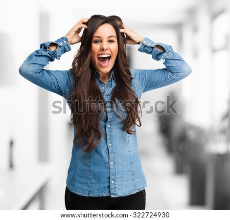 surprised young woman crazy pose - stock photo