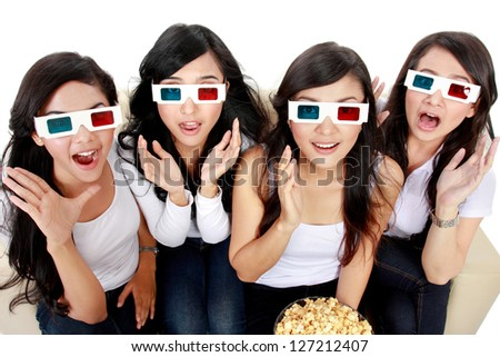 Surprised Young woman in 3D glasses and watching a movie