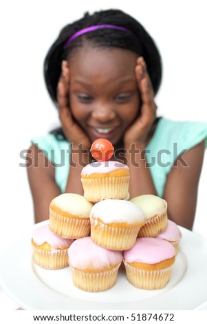 Surprised young woman looking at cakes against a white background - stock photo