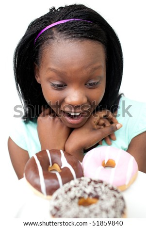 Surprised young woman looking at donuts against a white background - stock photo