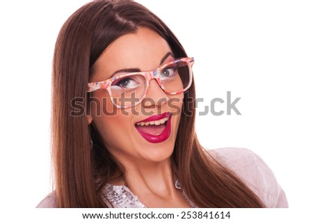 Surprised young woman with glasses on white background - stock photo
