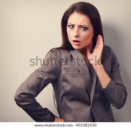 Surprising angry business woman with hand near face. Toned closeup portrait - stock photo