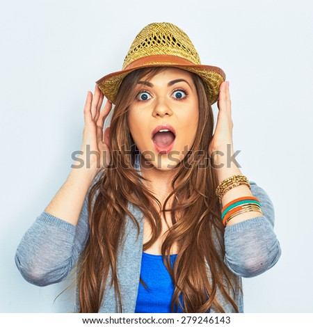 Surprising emotional woman portrait with yellow hat. Female model with long hair. Beautiful girl.