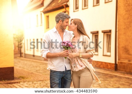 surprising girlfriend with bloom - stock photo