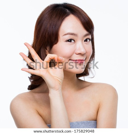 Surprising young Asian girl isolated on white background. - stock photo