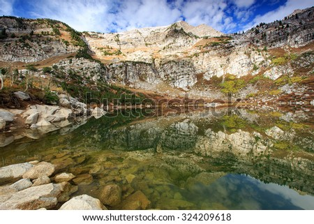 Surreal fall morning reflection in the Wasatch Mountains, Utah, USA. - stock photo