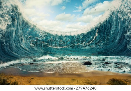 Surreal image of huge waves surrounding dry sand. - stock photo