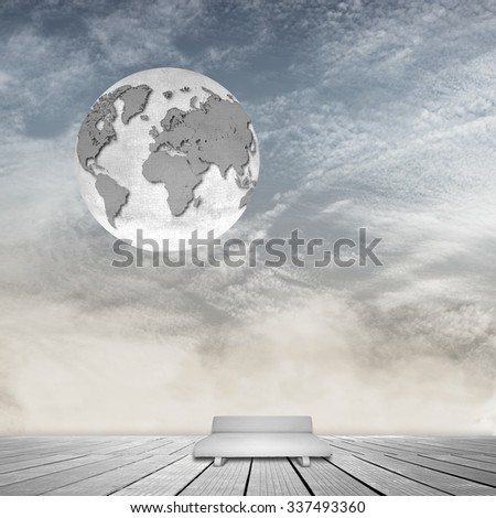 Surreal interior room with cloudy sky, gray sofa  and world globe - stock photo
