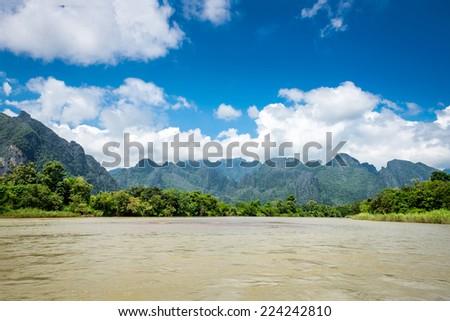 Surreal landscape by the Song river at Vang Vieng, Laos - stock photo