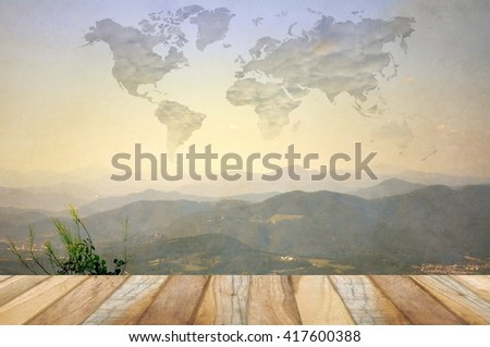 Surreal landscape with clouds in the form of earth map. Basic Earth image provided by NASA. - stock photo