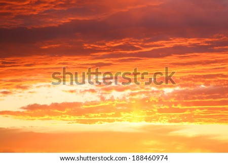 Surreal Orange Sky with clouds at dawn in South Africa on the Garden Road. - stock photo