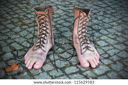 surreal photomontage of shoe and foot
