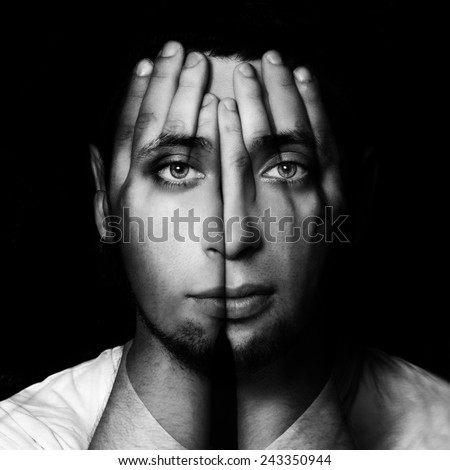 Surreal portrait of a man covering his face and eyes with his hands.Double exposure - stock photo