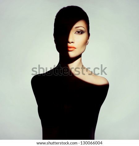 Surrealist art portrait of young lady with shadow on her body - stock photo