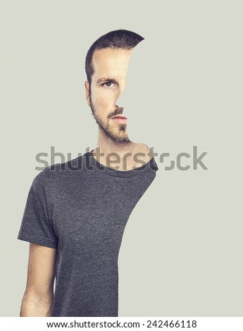 surrealistic portrait of a young man with cut out profile - stock photo