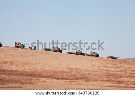 SURUC, TURKEY-NOVEMBER 7, 2014: The Turkish army tanks stay at the border of Suruc. The photo taken november 7, 2014. - stock photo