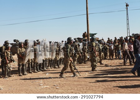SURUC, TURKEY-SEPTEMBER 21, 2014: Turkey opened its border to Syrians fleeing the town of Kobane in fear of an Islamic State attack. Turkish soldiers at the border. on september 21, 2014.  - stock photo