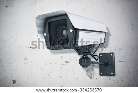 Surveillance Camera on concrete wall - stock photo