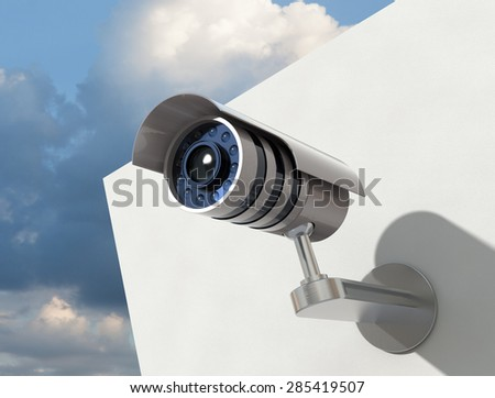 Surveillance camera on white wall on cloudy sky background easy to isolate for any other backdrop
