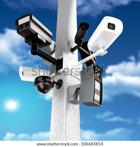 Surveillance mega camera's concept with a sky background - stock photo
