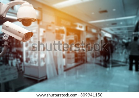 Surveillance Security Camera or CCTV in shopping mall - stock photo