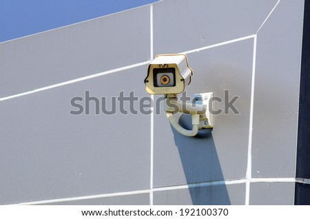 Surveillance Security Camera or CCTV on wall - stock photo