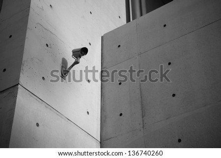 Surveillance Security Camera with Grunge concrete cement wall in the city - stock photo