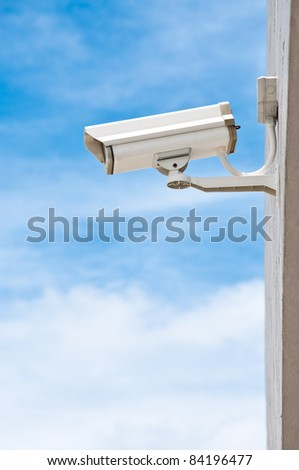 Surveillance Security Surveillance Security Camera or CCTV on blue sky