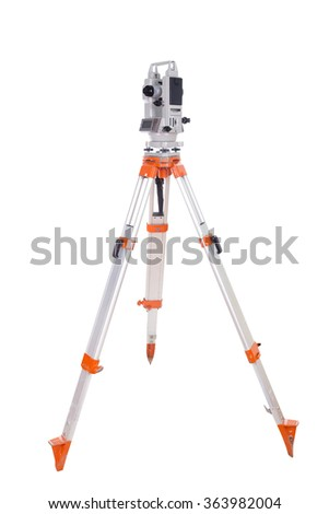 Survey equipment theodolite on a tripod. Isolated on white background
