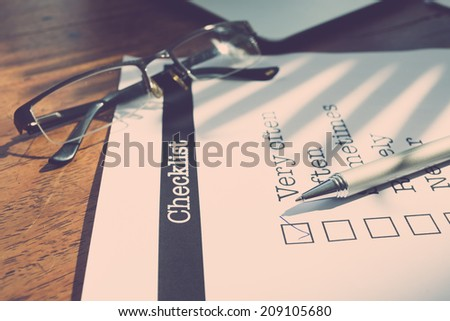 Survey form with a tick placed in checkbox - stock photo