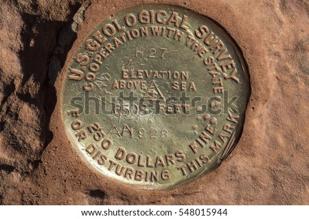 Survey marker at the top of Observation Point in Zion National Park in Utah, USA.