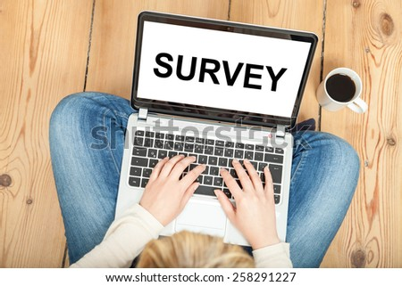 survey written on laptop for market research