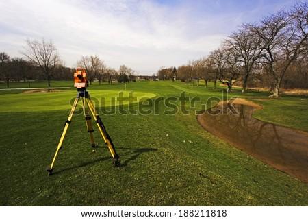 Surveying golf course - stock photo